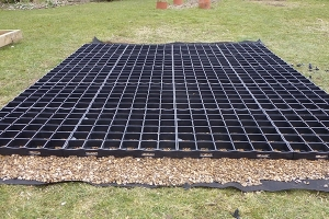 a Probase plastic shed base on a lawn