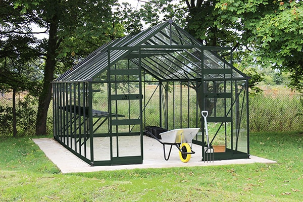 a 10x12 green-framed, polycarbonate greenhouse