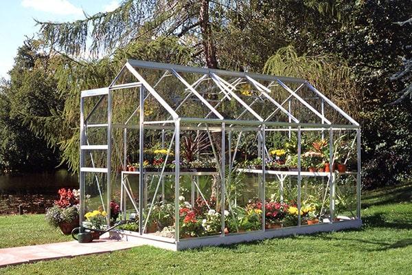an aluminium greenhouse full of plants
