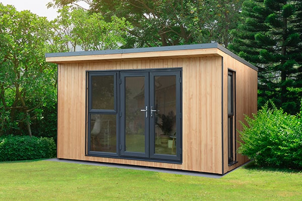 a garden office, made of structural insulated panels, with double doors and 2 full-length windows