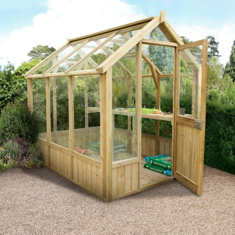a traditional, heavy-duty wooden greenhouse showin in situ