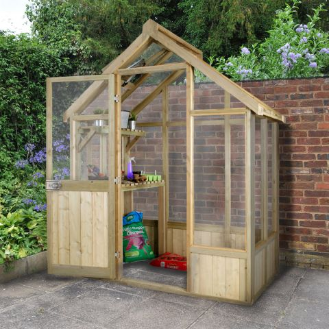 a traditional wooden greenhouse in situ with shelves