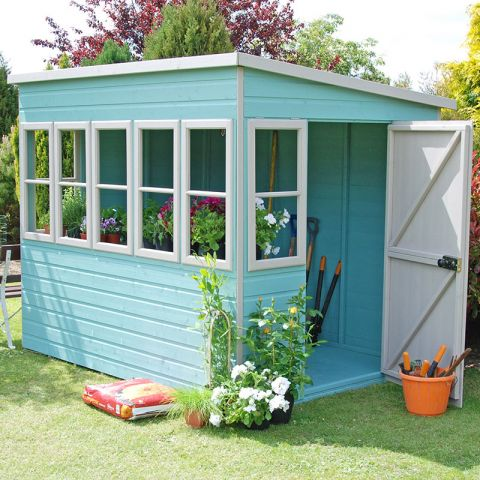 a pent wooden potting shed painted white and light blue