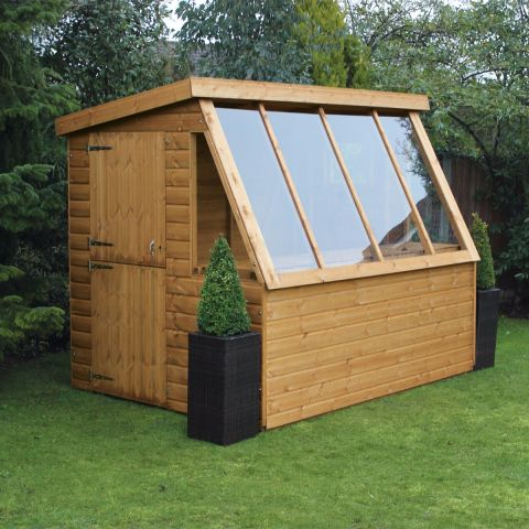 a traditional, wooden, pent potting shed with a single door and glass side