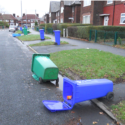 A street with wheelie bins out for collection.